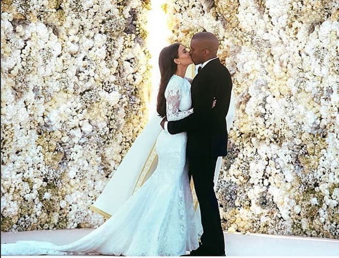 Kim Kardashian nee West walks down the aisle holding hands with her new husband, Kanye West, at Fort Belvedere as smiling guests look on. Pic Courtesy: Instagram