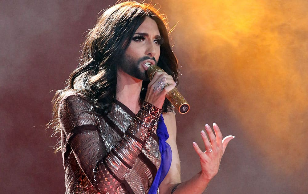 Austrian singer and Eurovision Song Contest winner Conchita Wurst performs on stage during the opening ceremony of the Life Ball in front of City Hall in Vienna, Austria.