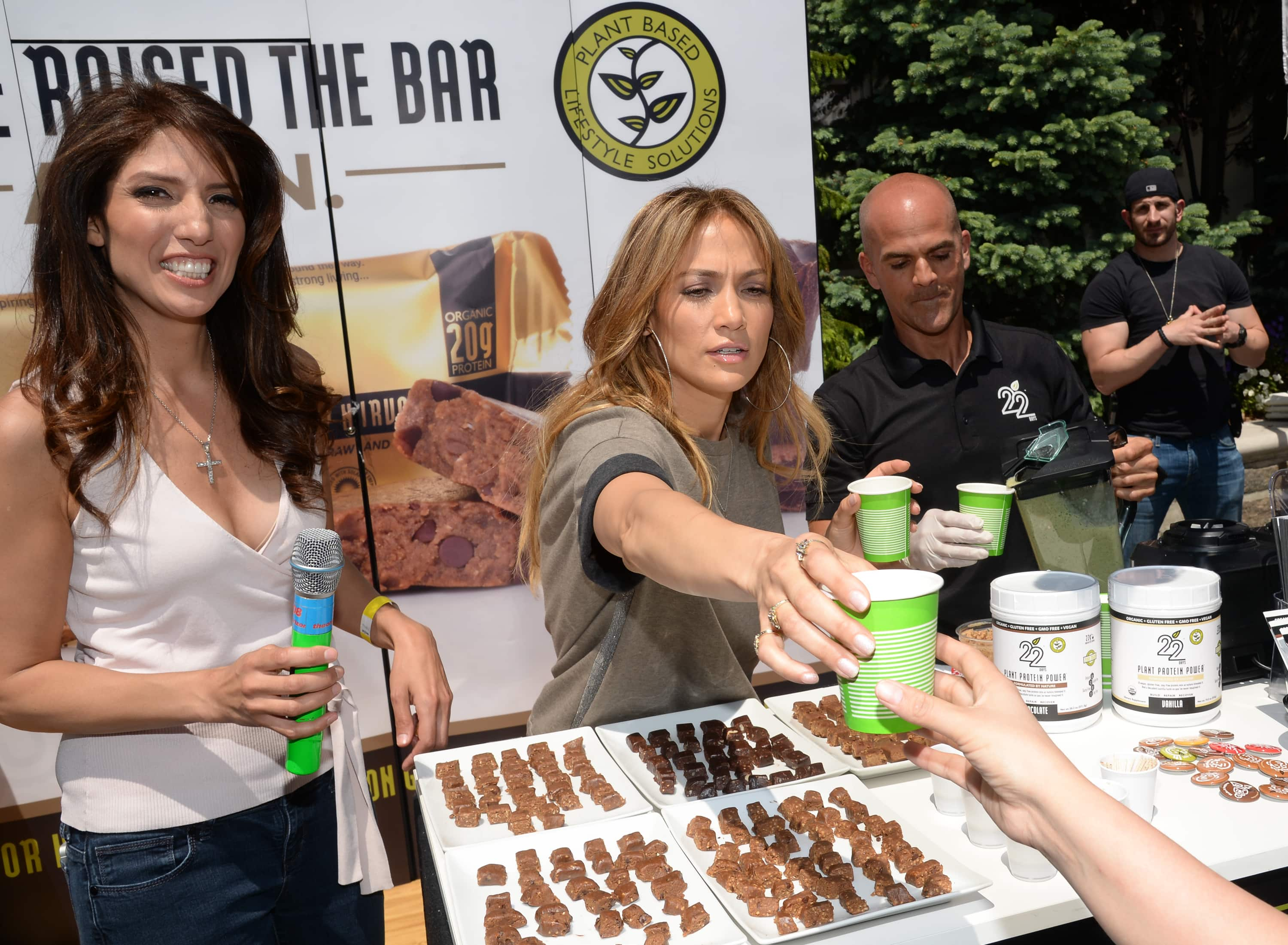 Singer and actress Jennifer Lopez passes out samples of a vegan, organic and gluten free shake with her sister Lynda Lopez at the Healthy Childhood initiative launch event, sponsored by the Montefiore Health System in partnership with the Lopez Family Foundation.