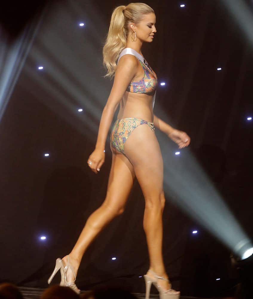 Miss California USA Cassandra Kunze participates in the swimsuit competition during the 2014 Miss USA preliminary competition in Baton Rouge, La.