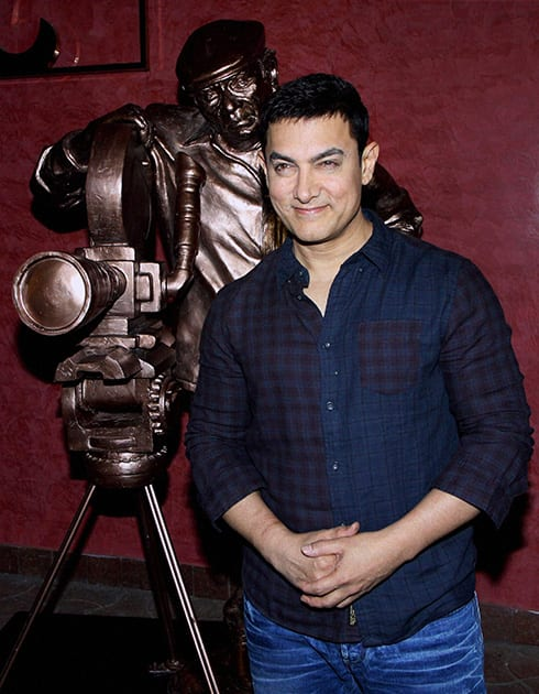 Aamir Khan poses during a promotional event in Mumbai.