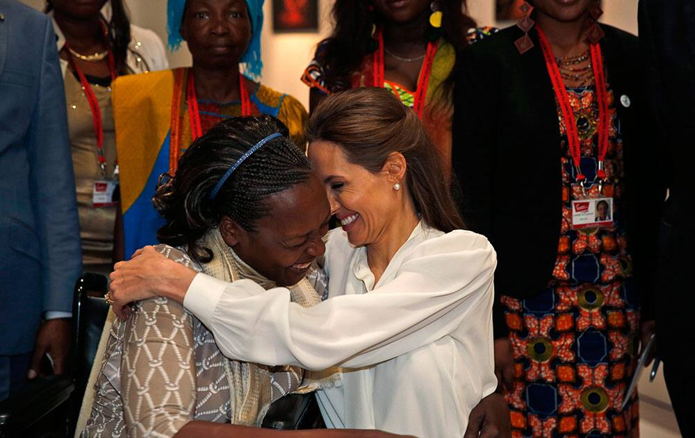 US actress Angelina Jolie, right, Special Envoy of the United Nations High Commissioner for Refugees, hugs Neema Namadamu of the Democratic Republic of Congo at the 'End Sexual Violence in Conflict' summit in London.