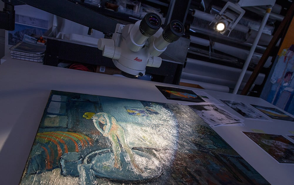 'The Blue Room,' one of Pablo Picasso's first masterpieces sits under a microscope at The Phillips Collection, in Washington. Scientists and art experts have found a hidden painting beneath the painting.