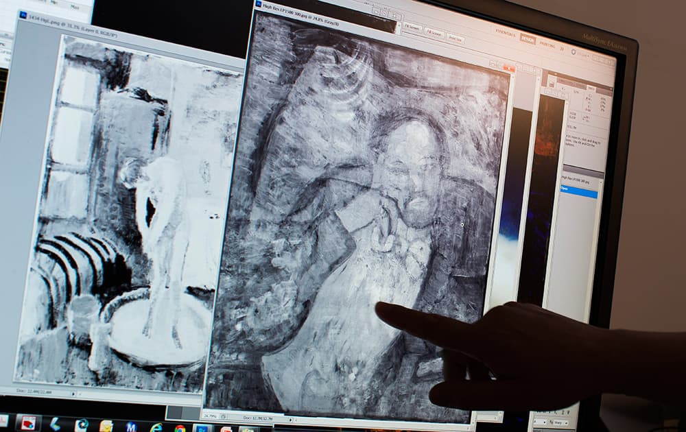 Patricia Favero, associate conservator at The Phillips Collection, points to an image of a man found underneath one of Picasso's first masterpieces, 'The Blue Room', in Washington.