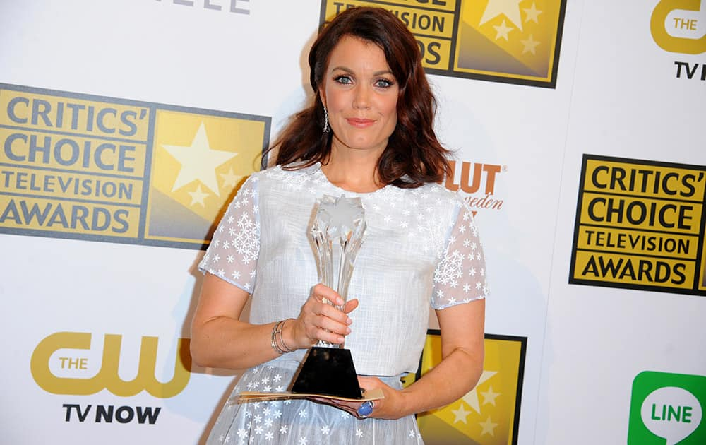 Bellamy Young poses with the award for best supporting actress in a drama series in the press room at the Critics' Choice Television Awards at the Beverly Hilton Hotel.