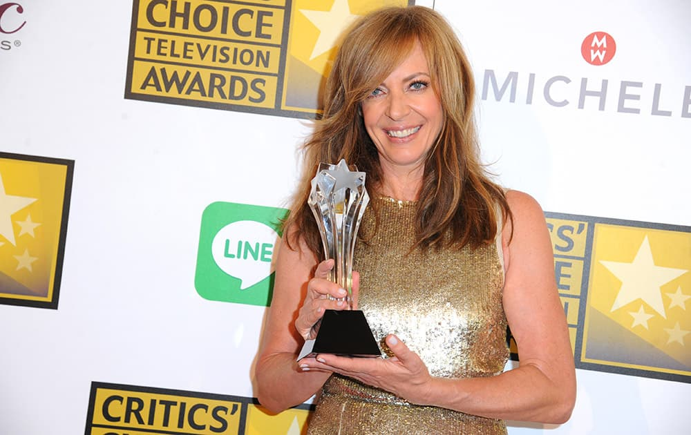Allison Janney poses with the award for best guest performer in a drama series for 'Masters of Sex' in the press room at the Critics' Choice Television Awards at the Beverly Hilton.
