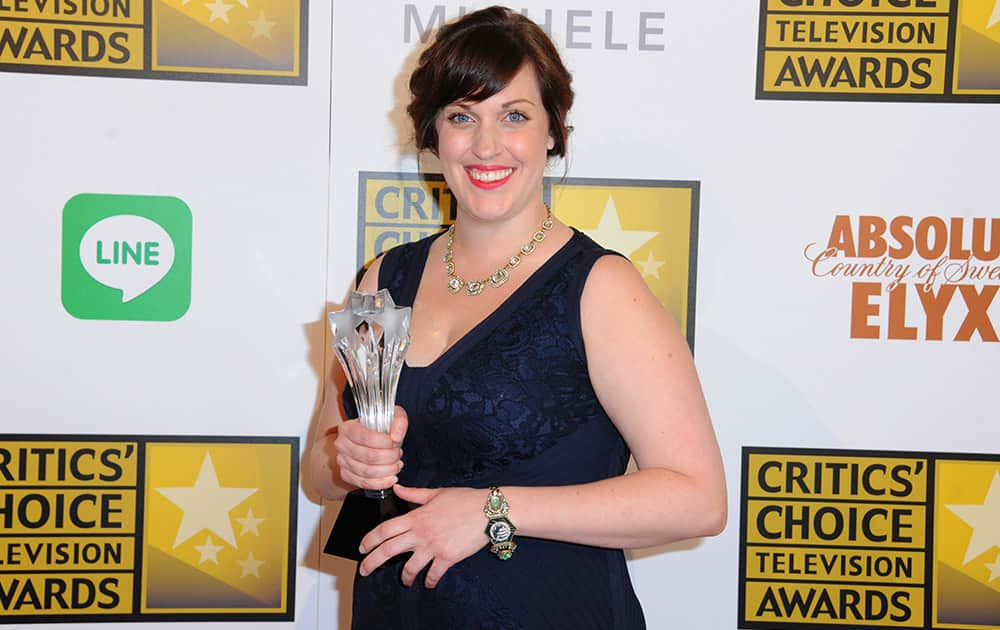 Allison Tolman poses with the award for best supporting actress in a movie or mini-series for 'Fargo' in the press room at the Critics' Choice Television Awards at the Beverly Hilton Hotel.