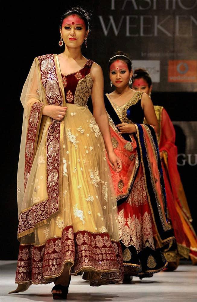 Models walk the ramp during a fashion show at ITA cultural complex in Guwahati.