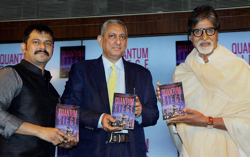 Bollywood Star Amithabh Bachchan with Mumbai Police Commissioner Rakesh Maria (C) and IPS officer, author Brijesh Singh at the launch of Brijesh's new book Quantum Siege in Mumbai.
