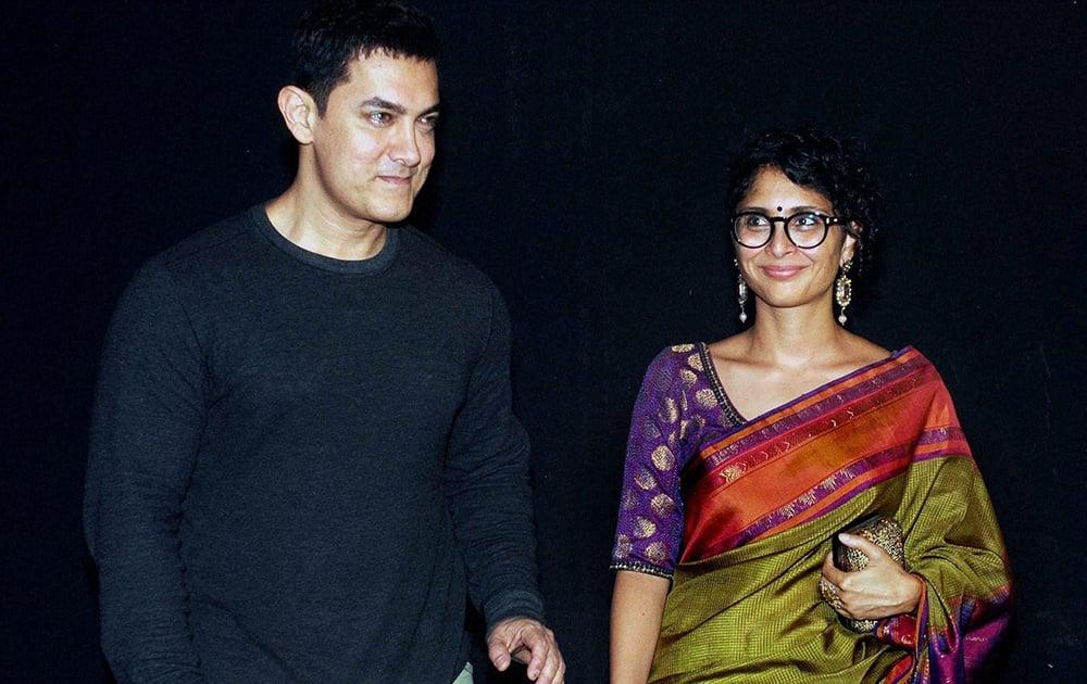 Aamir Khan with his wife, film producer & director, Kiran Rao during an Awards show in Mumbai.