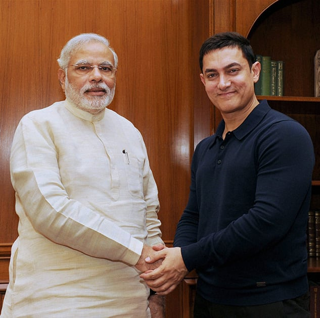 Prime Minister Narendra Modi shakes hands with actor Aamir Khan at a meeting in New Delhi.