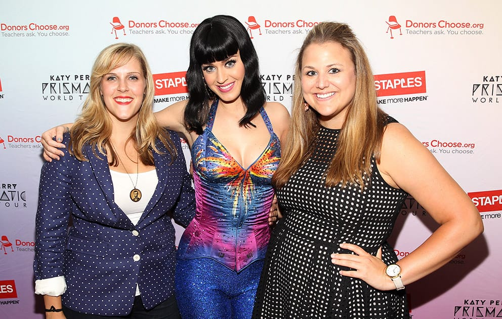 Global pop star Katy Perry with local teachers Julie Rukavina and Michelle Lee, backstage at the Verizon Center during her Prismatic World Tour performance, in Washington.