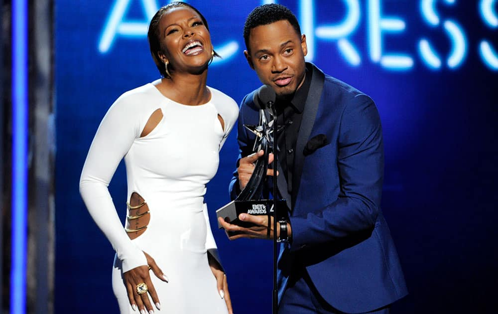 Eva Marcille, left, and Terrence J present the award for best actress at the BET Awards at the Nokia Theatre.