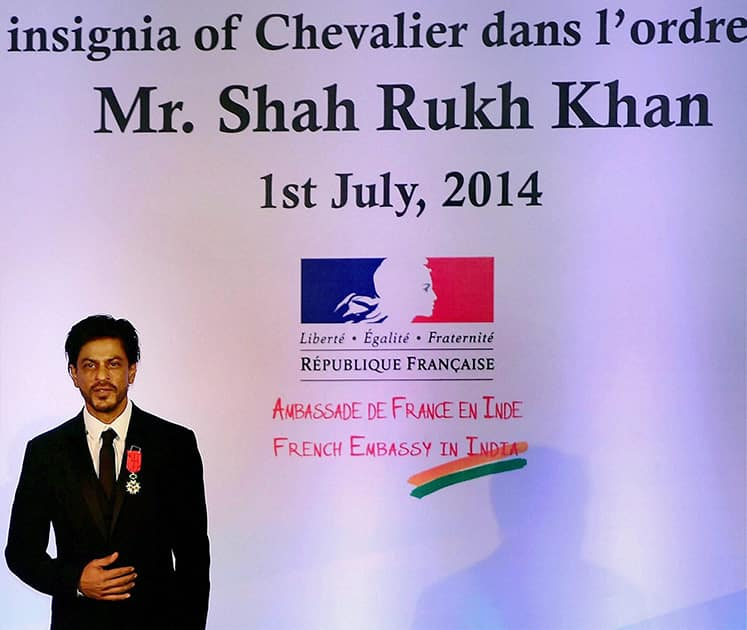 Bollywood superstar Shah Rukh Khan being conferred with Chevalier de la Legion d'Honneur, the highest Honour in France by Laurent Fabius, Minister for   Foreign Affairs and International Development of France in Mumbai.