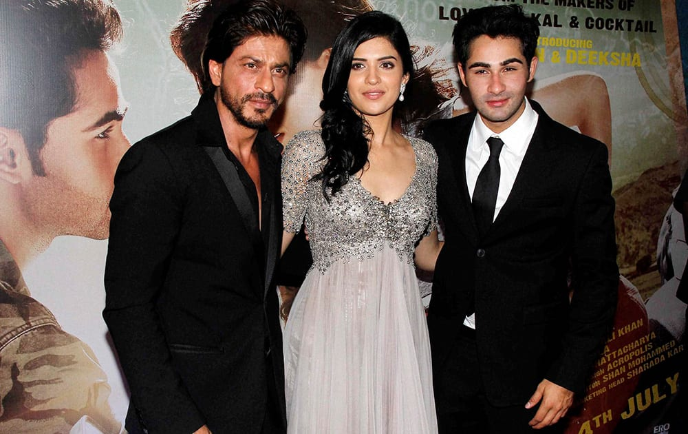 Bollywood actors Shahrukh Khan, Deeksha Seth and Armaan Jain during the premiere of film 'Lekar Hum Deewana Dil'.