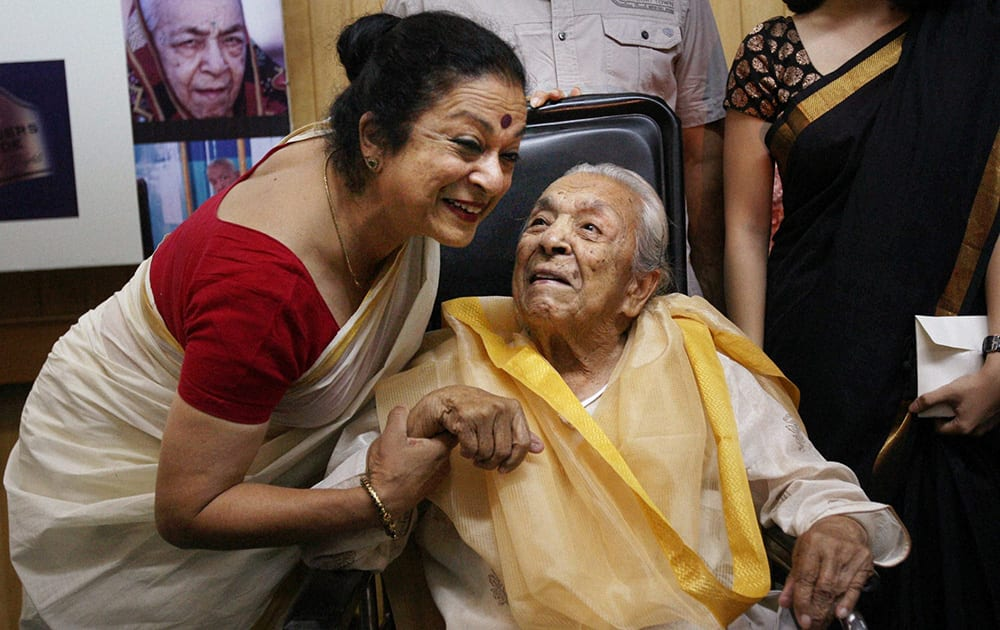 FILE- Veteran actress Zohra Sehgal with daughter Kiran Sehgal during a function on her 100th birthday in New Delhi in April 2012. Sehgal passed away at a hospital in New Delhi on Thursday.