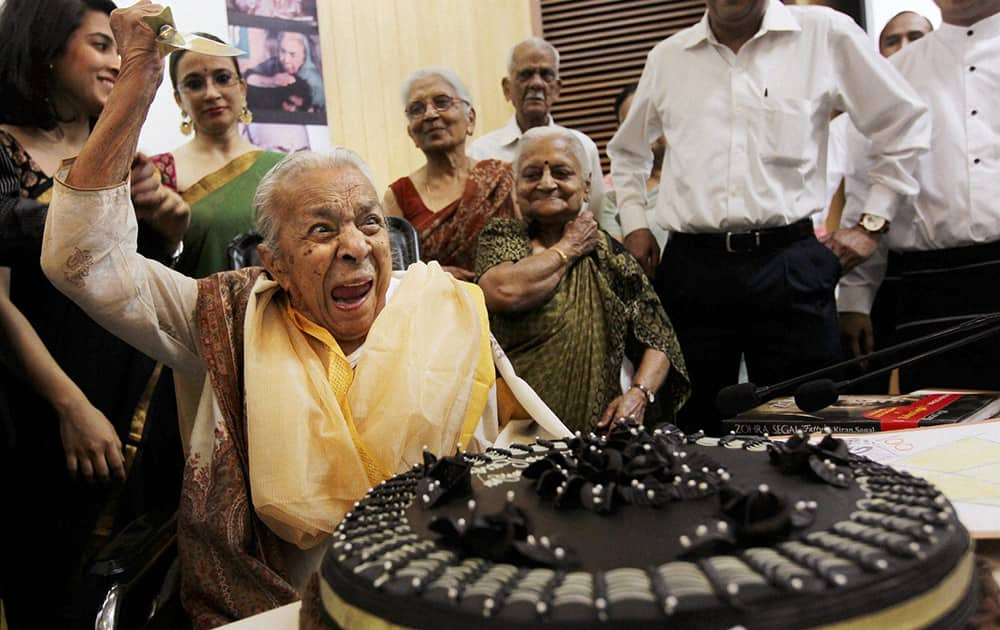 FILE- Veteran actress Zohra Sehgal reacts while cutting cake on her100th birthday in New Delhi in April 2012. Sehgal passed away at a hospital in New Delhi on Thursday.