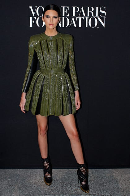Kendall Jenner poses as she arrives to attend the Vogue party, in Paris.