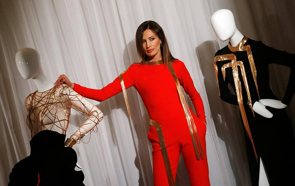 Spanish model Nieves Alvarez poses with creation on mannequins as part of Stephane Rolland's fall-winter 2014-2015 Haute Couture fashion collection in Paris.