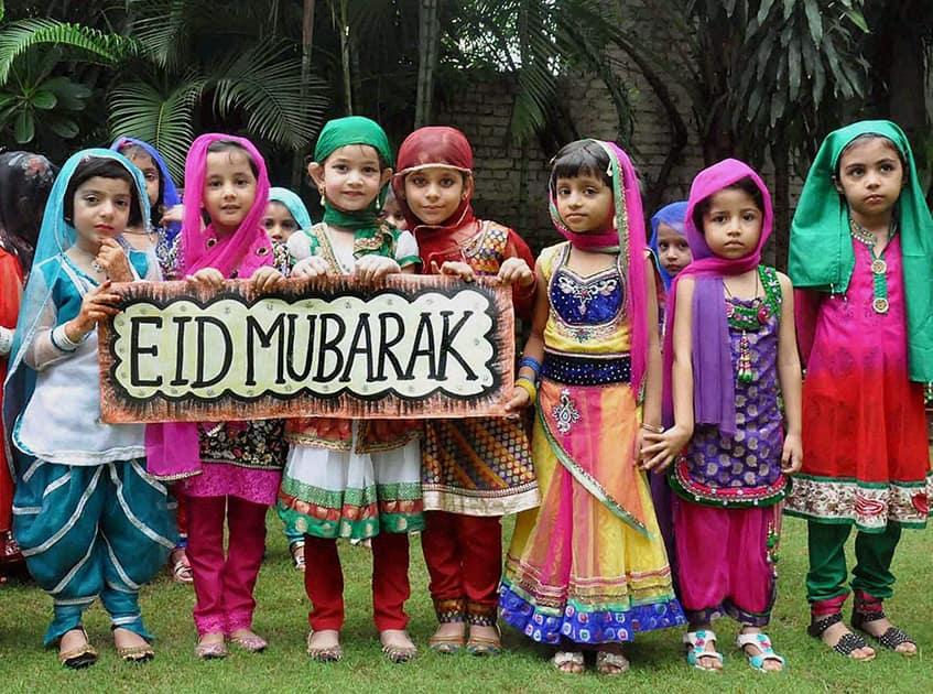 School kids take part in Eid celebrations at a school in Moradabad.