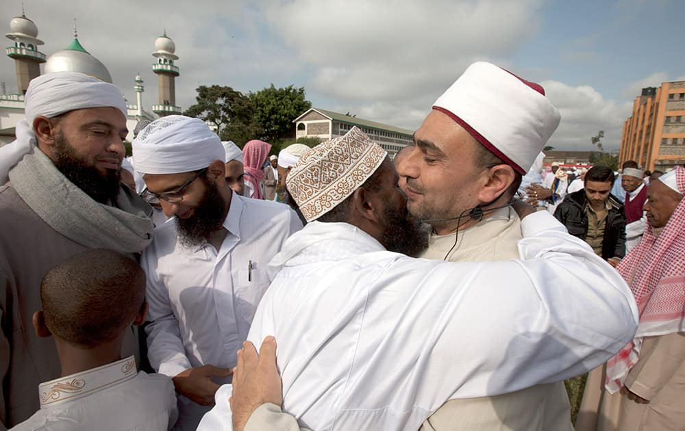 Hundreds of Kenyan Muslims embrace eachother outside Masjid Noor mosque after the end of the holy fasting month of Ramadan in Nairobi, Kenya.