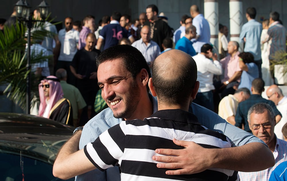 Muslims celebrate after a prayer session marking Eid al-Fitr the end of the Muslim holy fasting month of Ramadan at the Mosque and Islamic Cultural Center in Madrid.