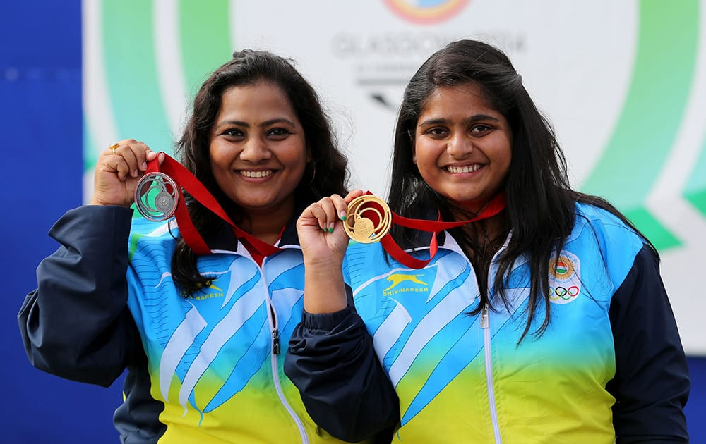 India`s gold medallist Rahi Sarnobatat, right, and silver medallist Anisa Sayyed pose for photographers following the 25m Pistol Women event at the Barry Buddon Shooting Centre in Carnoustie, Scotland, during the Glasgow 2014 Commonwealth Games.