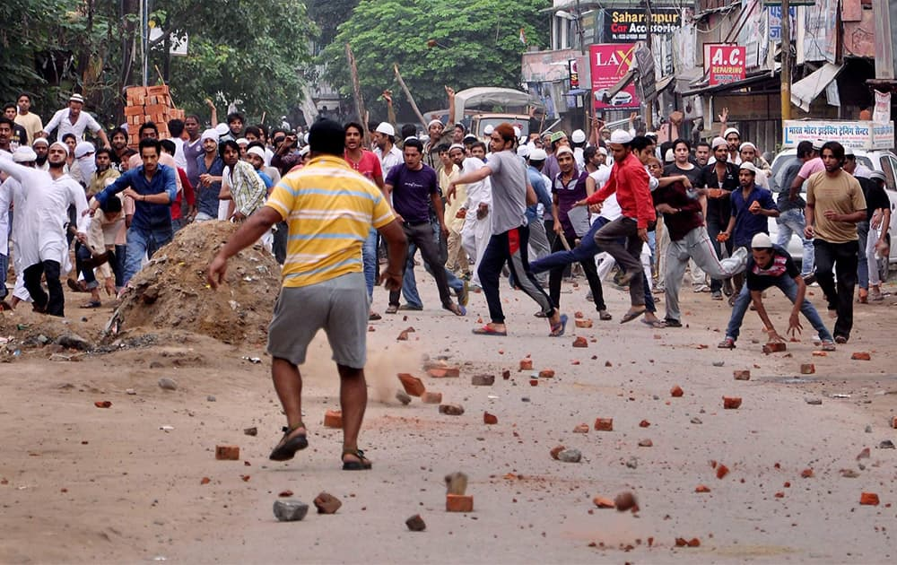 Stone pelters in action during violent clashes between two communities over a land dispute in Saharanpur.