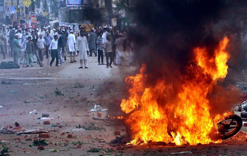 A bike burning during violent clashes between two communities over a land dispute in Saharanpur.