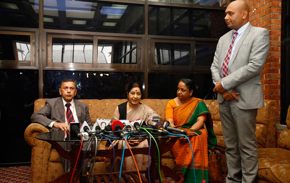 Indian Foreign Minister Sushma Swaraj speaks to the media upon arrival at the airport in Katmandu, Nepal.
