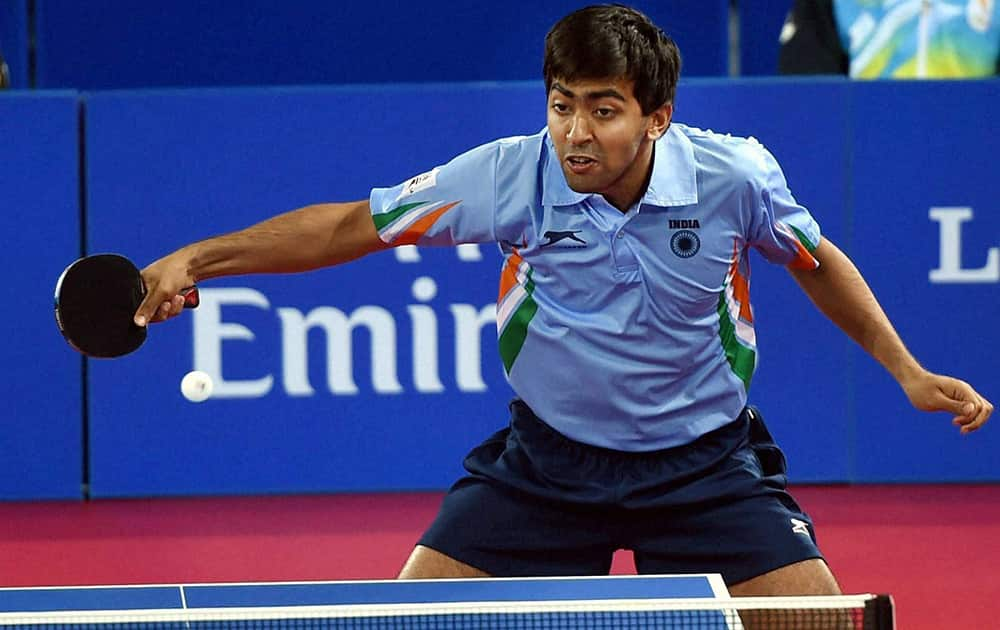 India`s Harmeet Rajul Desai in action against Vanuatu`s Ham Lulu during the Table Tennis men`s Team event at the Commonwealth Games in Glasgow, Scotland.