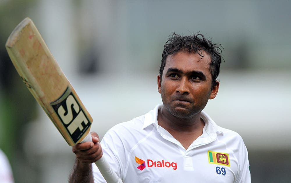 Sri Lankan cricketer Mahela Jayawardene celebrates his century during the first day of the second test cricket match between Sri Lanka and South Africa in Colombo, Sri Lanka.