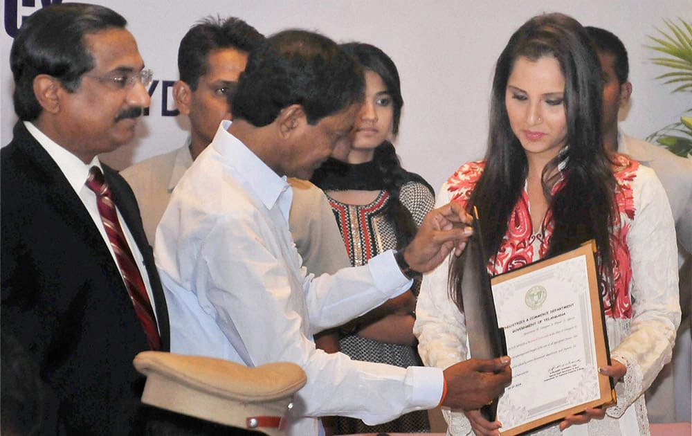 Telangana chief minister K.Chandrashekhar Rao presenting a letter of appointment as Telangana`s Brand Ambassador to Sania Mirza at ITC Kakatiya in Hyderabad.