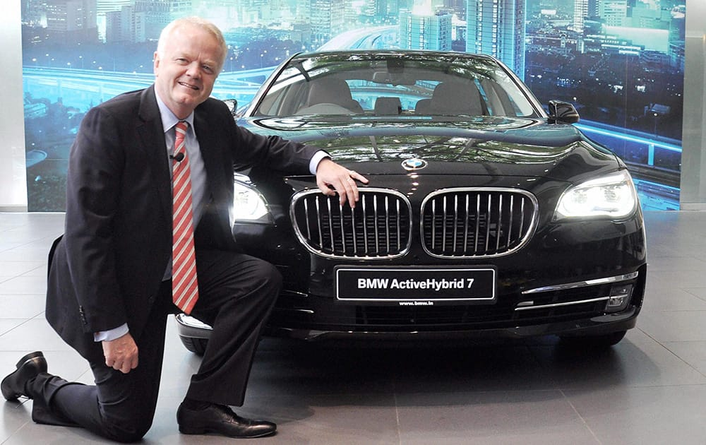 Philipp von Sahr, President, BMW Group India with the newly launched BMW Active Hybrid 7 car in Gurgaon.
