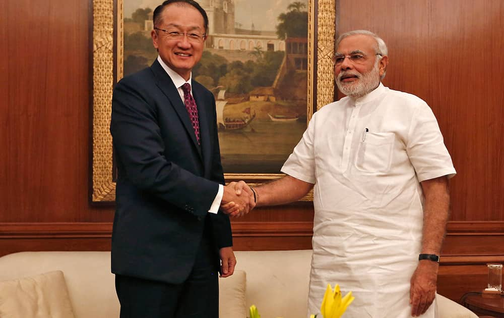 World Bank President Jim Yong Kim poses with Indian Prime Minister Narendra Modi before their meeting in New Delhi.