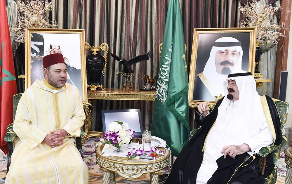 Saudi Arabia`s King Abdullah Bin Abdulaziz, right and Morocco's king Mohammed VI, left, pose at the Saudi monarch`s palace of Jeddah, Saudi Arabia.