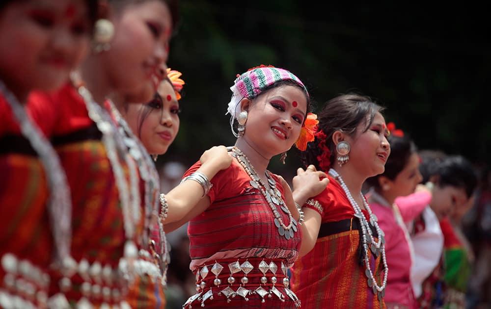 Indigenous Bangladeshi women dance during a celebration to mark International Day of the World`s Indigenous People in Dhaka, Bangladesh.