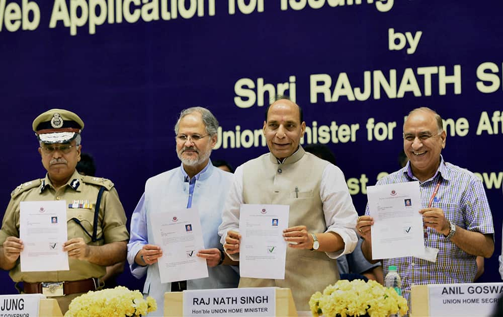 Union Home Minister, Rajnath Singh with Lieutenant Governor of Delhi, Najeeb Jung, Union home secretary Anil Goswami and Delhi Police Commissioner, B S Bassi at the launch of a web application of Delhi Police for issuing Police Clearance Certificate, in New Delhi.
