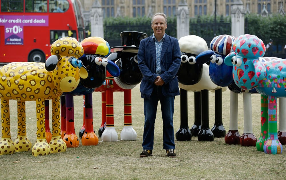 British director Nick Park, the creator of the Wallace & Gromit animated movies, poses for photographers with six sculptures of his animated character Shaun the Sheep in London.