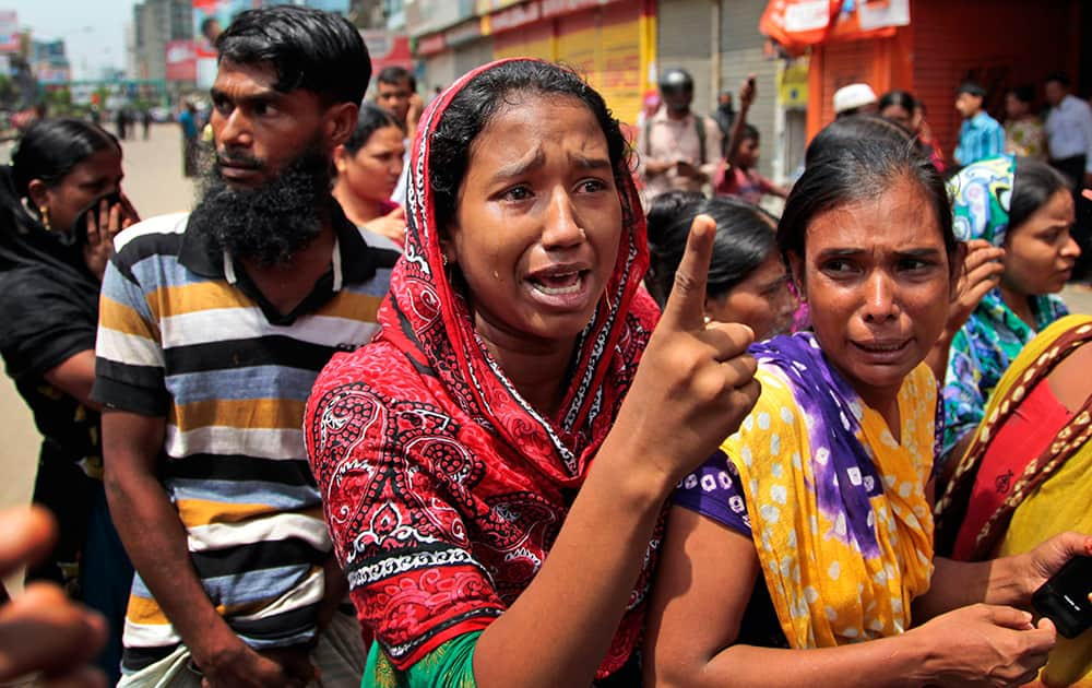 A Bangladeshi garment worker reacts before the media after police baton charged them in Dhaka, Bangladesh.