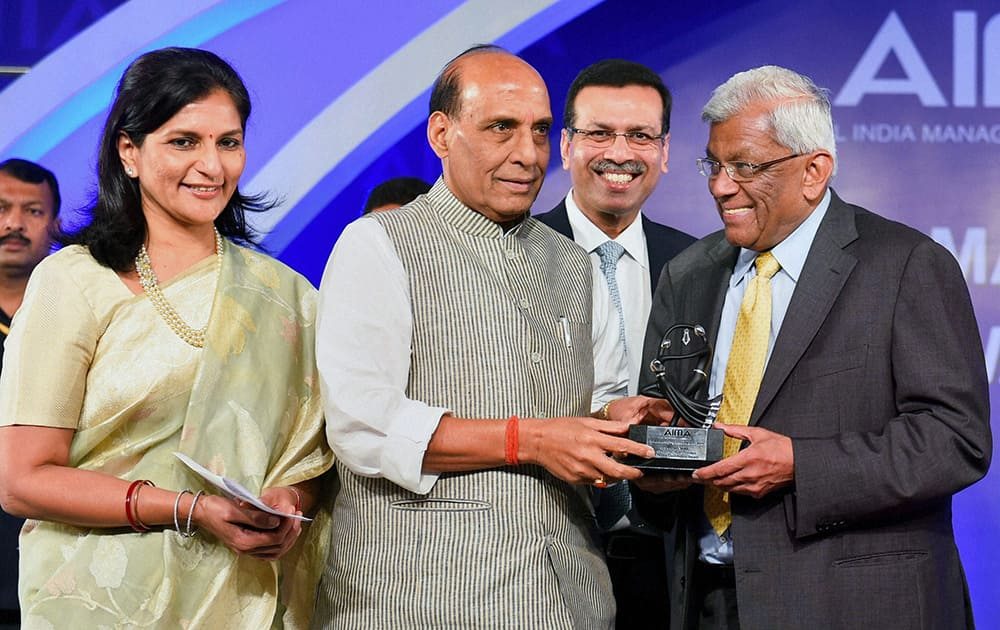 Union Home Minister Rajnath Singh presents Emerging Business Leader of the Year 2014 to Deepak Parekh, chairman, HDFC during the AIMA managing India awarrds 2014, in New Delhi.