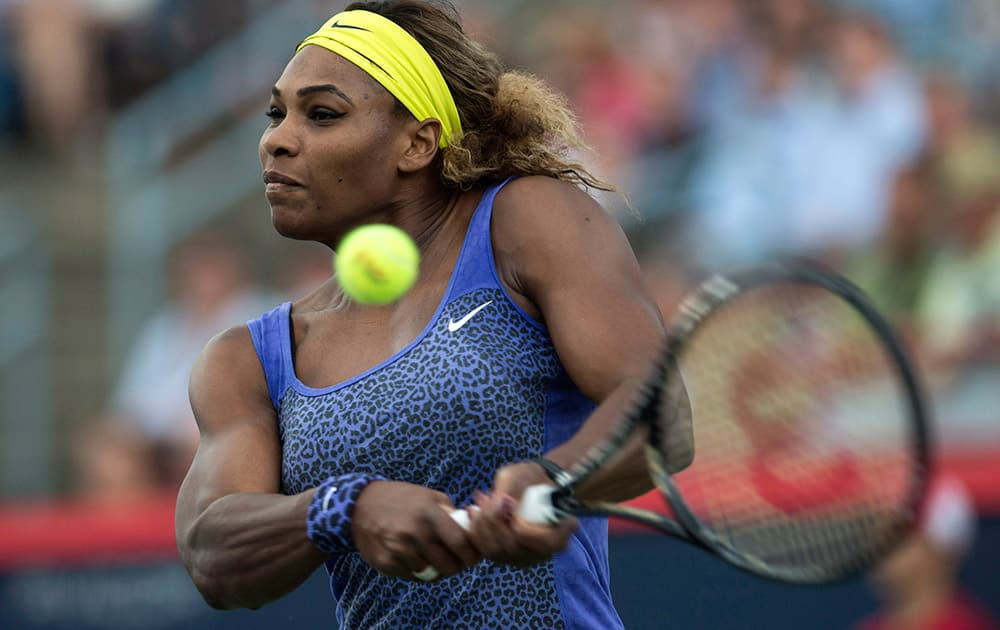 Serena Williams returns to Samantha Stosur, of Australia, at the Rogers Cup tennis tournament in Montreal.