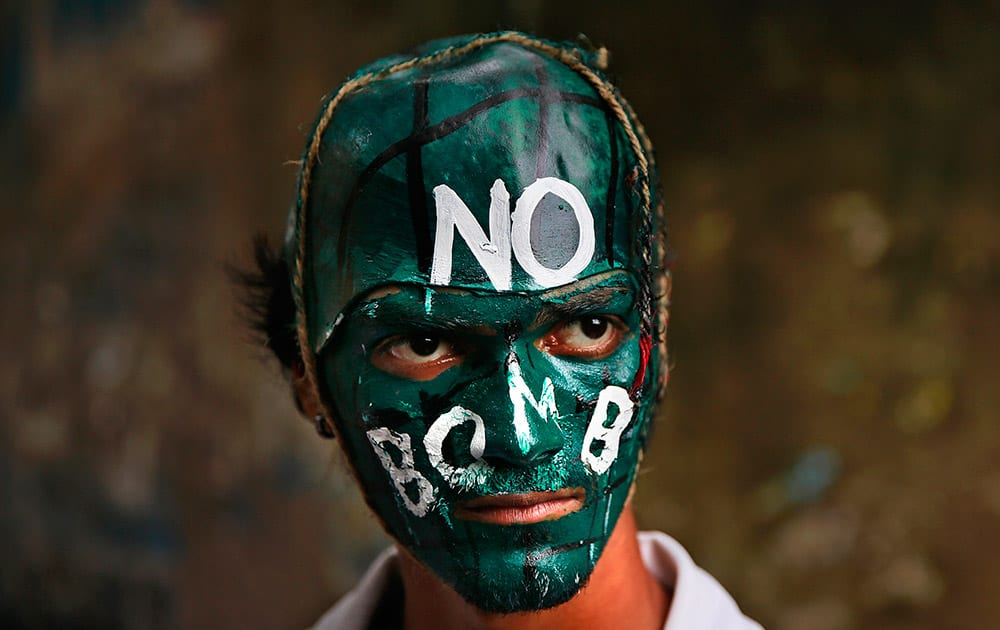 An indian student with painted face participates in a peace rally to mark the 69th anniversary of US atomic bombing of Hiroshima in Mumbai.