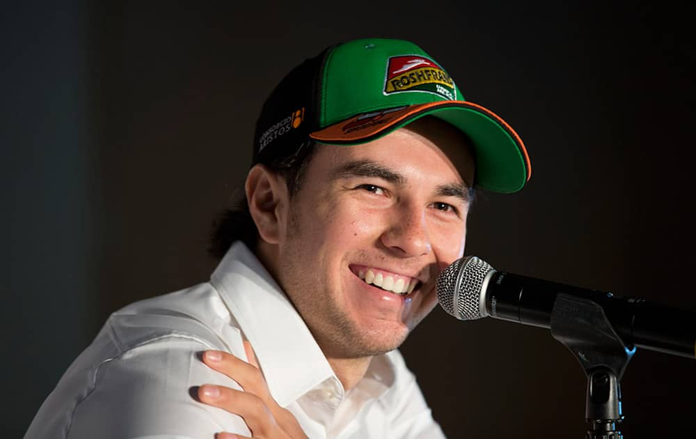 Force India driver Sergio Perez of Mexico smiles during a press conference in Mexico City. Formula One racing will return to Mexico in 2015 after an absence of 23 years.