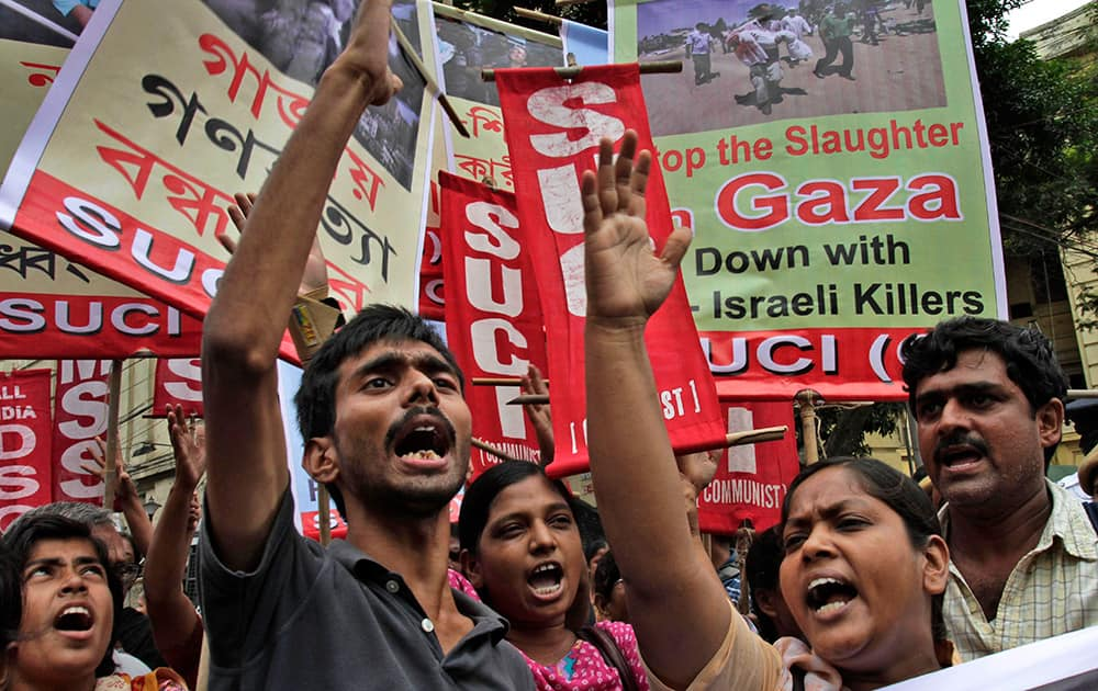 Activists of Socialist Unity Center of India, SUCI, shout slogans during a protest against Israel's attack on Gaza in Kolkata.