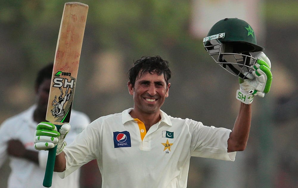 Pakistan`s batsman Younis Khan celebrates scoring a century during the first day`s play of the first test cricket match between Sri Lanka and Pakistan in Galle, Sri Lanka.