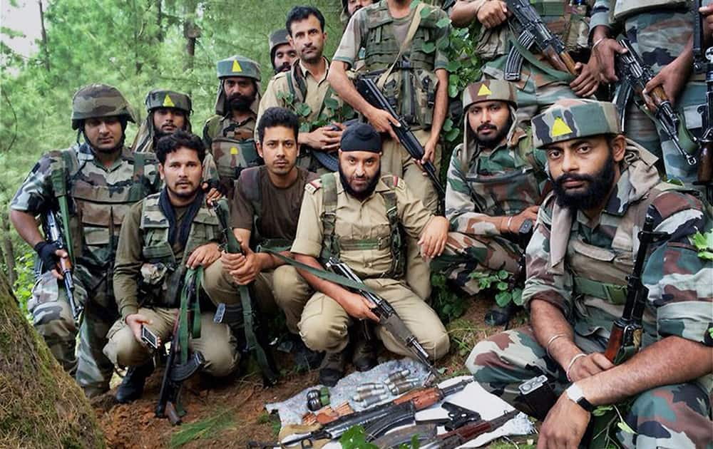An army unit displays arms and ammunition operation in Kupwara district.