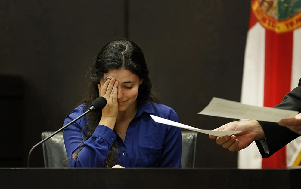 Erika Friman, the girlfriend of slain University of Florida student Christian Aguilar, pauses during the reading of a series of text messages between her and former boyfriend Pedro Bravo while on the stand in Bravo`s murder trial at the Alachua County Criminal Justice Center in Gainesville, Fla.