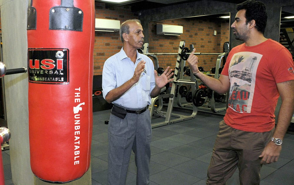 BCCI`s West Zone in-charge of Ground and pitch committee, Sudhir Naik (L) with cricketer Zaheer Khan at the latter`s fitness center, Prosport, in Mumbai.