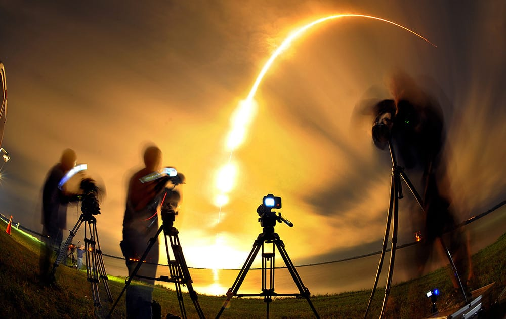The media watches as a Space X falcon 9 rocket carrying the AsiaSat 8 Satellite liftoff from the Cape Canaveral, Fla., Air Force Station.